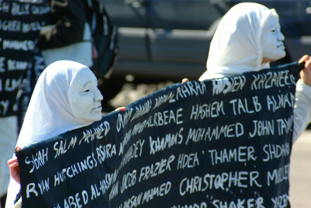 "Anti War demonstrators carry the names of those who've died trying to ""take"" Iraq's oil. Photo by Paul Udstrand"