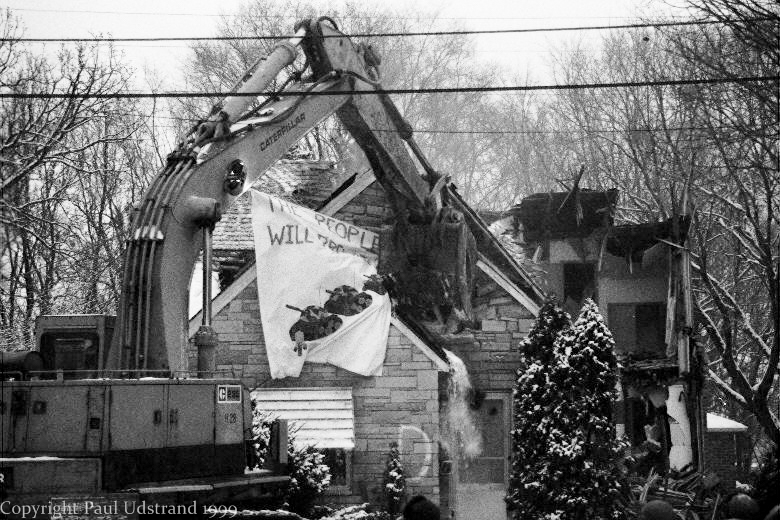 "Workers tear down previously occupied houses after arresting and evicting ""occupiers"""